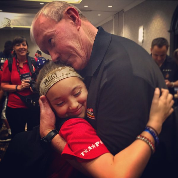 Lizzy hugging now-retired Gen. Dempsey at this year's TAPS Good Grief Camp in DC. (Photo: TAPS.org)