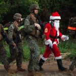 These 9 photos show Santa is a man of many MOSs