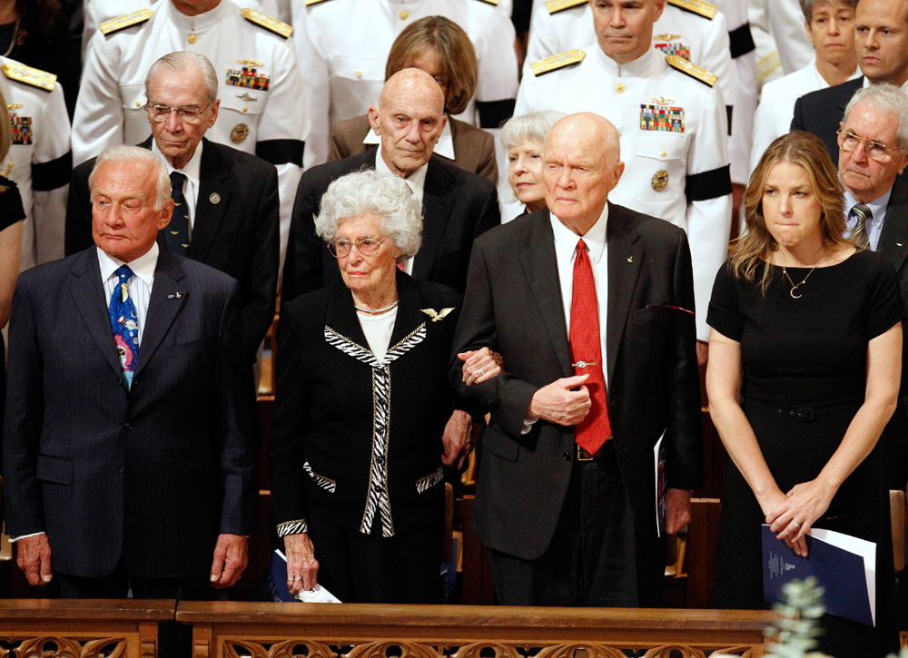 From left, astronaut Buzz Aldrin, Annie Glenn, astronaut and former Ohio Sen. John Glenn, and singer Diana Krall, stand during the opening processional at the Washington National Cathedral in Washington, Thursday, Sept. 13, 2012, during a national memorial service for the first man to walk on the moon, Neil Armstrong. (AP Photo/Ann Heisenfelt)