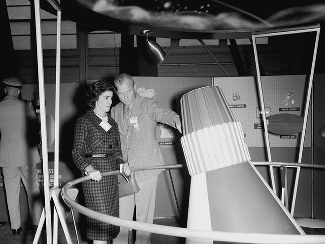 John shows Annie a mockup of the Mercury capsule before his mission in 1962. (Photo: NASA)