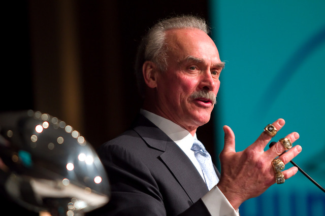 Rocky Bleier shows off his four Super Bowl rings while presenting the keynote for the U.S. Bank Humanitarian Awards Banquet.