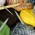 Seamstress knit caps for soldiers, cancer patients